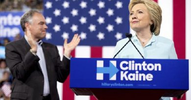 Democratic presidential candidate Hillary Clinton accompanied by Sen. Tim Kaine, D-Va., left, speaks at a rally at Florida International University Panther Arena in Miami, Saturday, July 23, 2016. Clinton has chosen Kaine to be her running mate. (ANSA/AP Photo/Andrew Harnik) [CopyrightNotice: Copyright 2016 The Associated Press. All rights reserved. This material may not be published, broadcast, rewritten or redistribu]