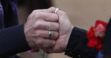 Steve Davis and James Farless hold hands as they are married by Rev. Marge Ragona, Metropolitan Community Church, in Linn Park, at the Jefferson County courthouse, Monday, Feb. 9, 2015, in Birmingham, Ala. A federal judge's order overturning the state's ban on gay marriage goes into effect on Monday, making Alabama the 37th state to allow gays and lesbians to wed. (ANSA/AP Photo/Hal Yeager)