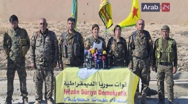 """This frame grab from video provided by Arab 24 network, shows officials with the U.S.-backed Syria Democratic Forces at a press conference in Ein Issa in northern Syria. U.S.-backed Kurdish-led Syrian forces announced their plan Sunday to retake the Islamic State group's de facto capital of Raqqa, saying they hoped Turkey would not """"interfere in internal Syrian affairs."""" (Arab 24 network, via AP)"""